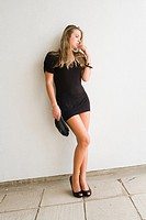 Fanciful young lady dressed in short Black dress