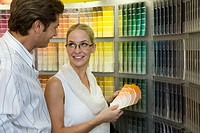 Couple looking at color swatches in store
