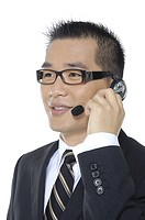 Close_up of a male customer care executive adjusting his headset