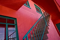 Stairway at brightly colored apartment building, Truth or Consequences, New Mexico, USA