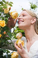 Woman sniffing a fragrant rose
