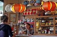 WAITRESSES IN FRONT OF THE BAR OF THE CAFE LE DELIC SPECIALIZING IN HOME_MADE PASTRIES, PLAZA DE LA PAJA, MADRID, SPAIN