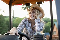 Woman driving tractor