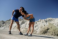Athletic young couple exercising outdoors.