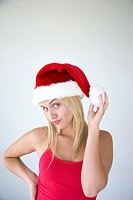 Woman wearing Santa Claus hat                                                                                                                         ...