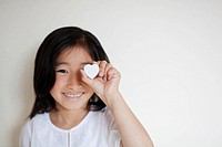 Girl Holding Love Heart in Front of her Eye