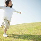 Young Girl Running in Grass