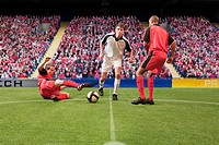 Football players kicking the ball