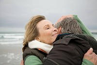 Mature couple hugging at the coast
