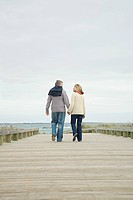 Couple holding hands on walkway