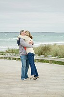 Couple hugging at the coast
