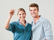 Young couple holding house keys (thumbnail)
