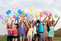 Young people holding balloons