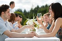 Young couple at outdoor dinner party