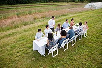 People at dinner party on a farm