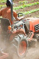 Farmer using tractor