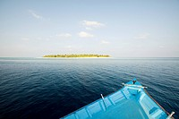 Boat and Havodigalaa Island, South Huvadhu Atoll, Maldives
