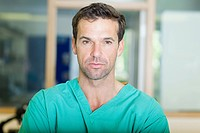 Male surgeon looking serious