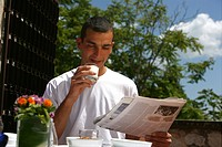 Man having breakfast outdoors                                                                                                                         ...