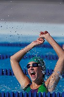 Woman winning swimming competition                                                                                                                    ...