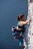 Woman rock climbing ...