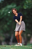 Woman playing golf                                                                                                                                    ...