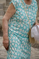 torso of an elderly woman walking