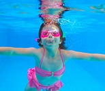 underwater little girl pink bikini goggles blue swimming pool