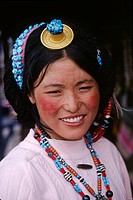 A TIBETAN BEAUTY wears TURQUOISE, CORAL, Z_STONES & A GOLD & CORAL HAIR PIECE _ LHASA, TIBET
