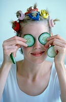 Woman with cucumber on her eyes.