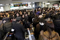 crowd trying to exit and enter the subway Japan