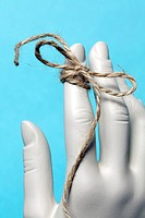 string tied around female mannequin finger