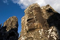 The face towers of The Bayon at Angkor Thom, the largest Khmer city ever built, are part of the Angkor Wat complex _ Siem Reap, Cambodia