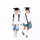 children smiling and wearing graduation hat