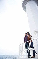 a couple looking at the sky with putting arms around each others shoulders