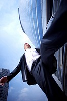 man running in front of the building at low angle