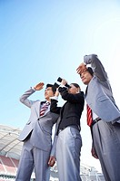 three person looking at somewhre through binocular