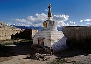 A pilgrim cirmcmnambulates a Chorten at Sera Monastery _ Lhasa, Tibet