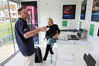 A employee of KPN gives information about digital media, Netherlands