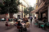 Spain, Andalusia, Seville, street with restaurants