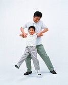 Front view of a man lifting his son