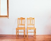 Two wooden chairs on floor