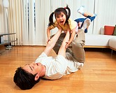 A man heaving his daughter with his legs