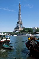 Eiffel Tower with river boats on Seine River Paris, Ile_de_France