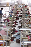 Readymade garment factory Interior people working on sewing machine Suditi Industries at Bombay Mumbai, Maharashtra, India