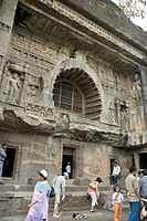 Tourists standing at front view of cave No. 26 , Ajanta , Aurangabad , Maharashtra , India