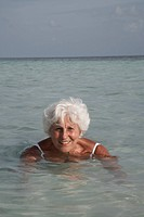 Maldives, Ari Atoll, senior woman in the sea