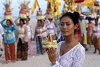 Balinese girl with offering during a ceremony, Bali, Indonesia