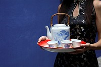 Tray with chinese teapot and teacups
