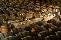 A well_laid table in a wine cellar